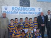 U8 players show off their medals with Jimmy O'Gorman and Tom Cunningham at the Roanmore Charity Blitz