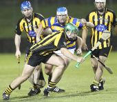 Ian Kiely chases down his Brickey Rangers opponent during the Western Junior Hurling (Intermediate Attached) Final at Fraher Field