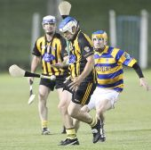 Barry Henley concentrates on hooking his Brickey Rangers opponent during the Western Junior Hurling (Intermediate Attached) Final