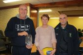 Niamh Enright and Michael Ferncombe present a Waterford Crystal vase to the visiting Australian team mentor
