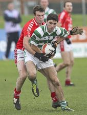 Conor Moloney in possession of the football during the County Senior Football Championship Final against Stradbally at Fraher Field