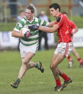 Gary Hurney holds off his Stradbally opponent during the County Senior Football Championship Final at Fraher Field