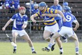 Gary Hurney breaks through the Fourmilewater back line during the County Senior Hurling Quarter Final at Fraher Field
