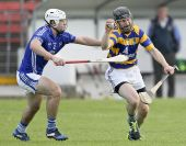 Gavin Breen rounds his man in the Senior Hurling match v Dungarvan at Fraher Field