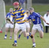 John Gorman solos away from the Dungarvan attack in the County Senior Hurling Championship