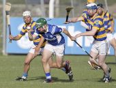 John Hurney and Mark Ferncombe try to disposes the Fourmilewater defence during Abbeyside's County Senior Hurling Championship win at Fraher Field