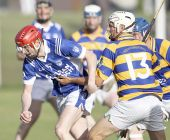 Mark Ferncombe getting to grips with the Fourmilewater defence during the County Senior Hurling Championship Quarter Final at Fraher Field