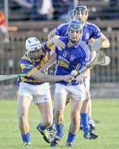 Maurice Power battles for possession in the County Senior Hurling Championship game against Dungarvan at Fraher Field