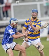Gary Hurney offloads the sliothar to a team mate during the County Senior Hurling Championship match with Mount Sion at Walsh Park