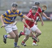 Brian Looby rushes to pick up possession during the County Senior Hurling Championship match v Passage at Walsh Park