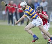 Richie Foley battles to free himself from the shackles of his opponent during Abbeyside's County Senior Hurling Championship victory over Passage at Walsh Park