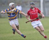Richie Foley trying to prevent a Passage clearance during the County Senior Hurling Championship clash at Walsh Park