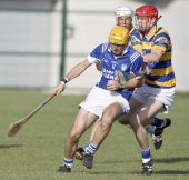 Patrick Hurney pressurising his Fourmilewater opponent during the County Senior Hurling Championship Quarter Final