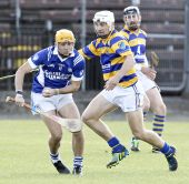 Richie Foley tracking his opponent in the County Senior Hurling Quarter Final match v Fourmilewater