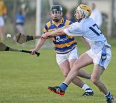 Brian Looby, eye on the sliothar, aims to block an effort from his Roanmore marker during the County Senior Hurling Championship match at Kill