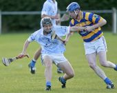 John Hurney refusing his opponent easy possession during the County Senior Hurling Championship match against Roanmore played at Kill