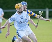 John Hurney focuses on dispossessing his opponent during the County Senior Hurling Championship match v Roanmore at Kill