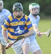 Maurice Power solos clear from his Roanmore marker during the County Senior Hurling Championship victory played at Kill