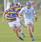 Shane O'Donovan chases his Roanmore opponent during the County Senior Hurling Championship match at Kill