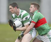 Gary Hurney battles to keep possession v Rathgormack in the first round of the County Senior Football Championship