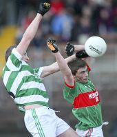 Seán O'Hare rises high to win possession for Ballinacourty in the County Senior Football Championship v Rathgormack