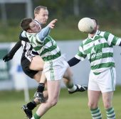 Patrick Lynch rises high against St. Saviours in the second round of the County Senior Football Championship