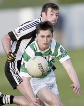John Power focuses on securing possession during the County Senior Football Championship match v St. Saviours in Walsh Park