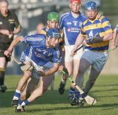 John Hurney and Seán O'Hare track their Dungarvan opponent during the recent County Senior Hurling Championship match at Fraher Field