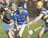 The Gorman brothers battle to steal possession during Abbeyside's Senior Hurling Championship third round encounter with Dungarvan