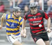 Shane O'Donovan tracks him Ballygunner opponent during the County Senior Hurling Championship at Walsh Park