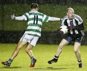 Mark Ferncombe attempting to dispossess his St. Saviour's opponet during the County Senior Football Championship Quarter Final at Fraher Field