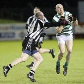 Shane Briggs attempts to break a St. Saviour's tackle during the County Senior Football Championship Quarter Final played at Fraher Field